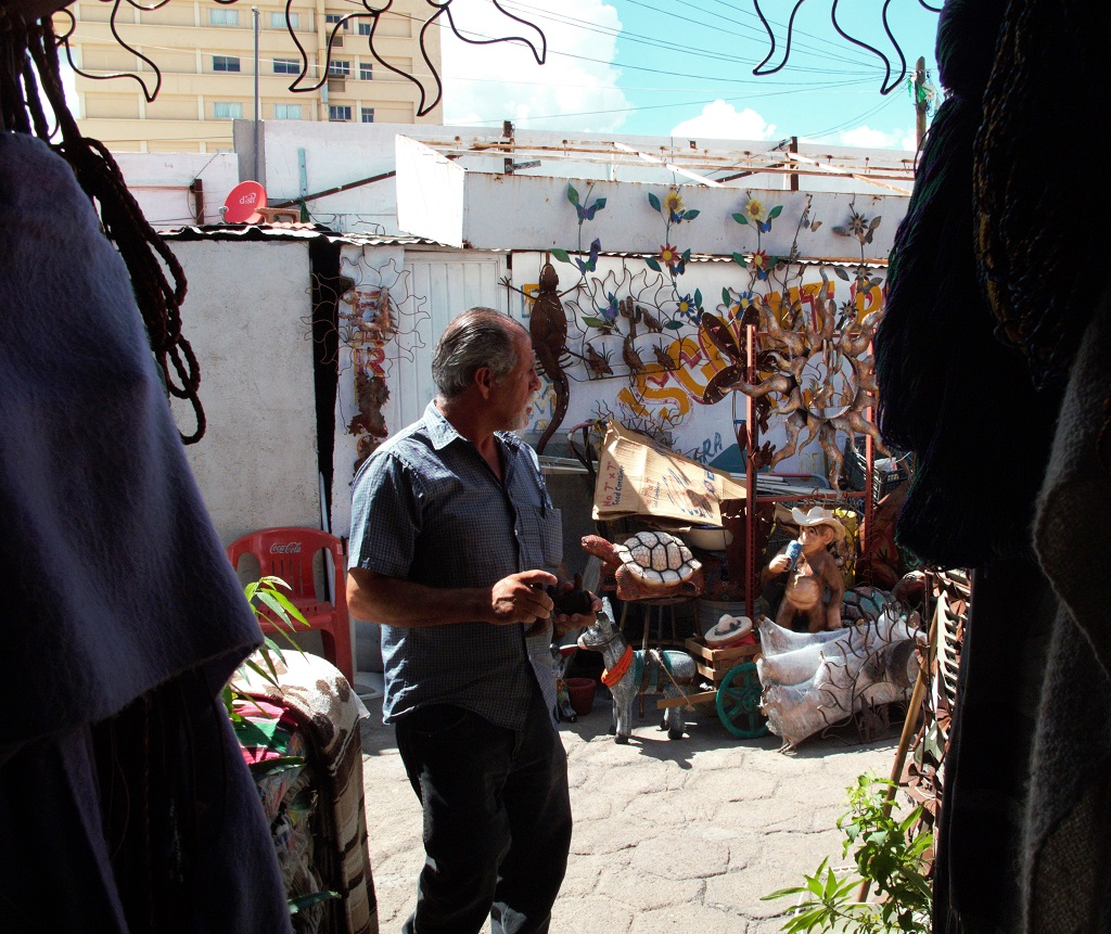 A shopkeeper outside his shop in the maze-like market near the Nogales gate.
